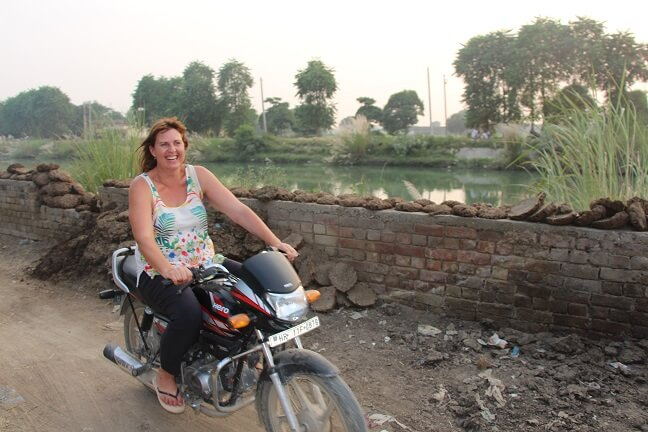JJ from Recycled Mats riding motorbike in India