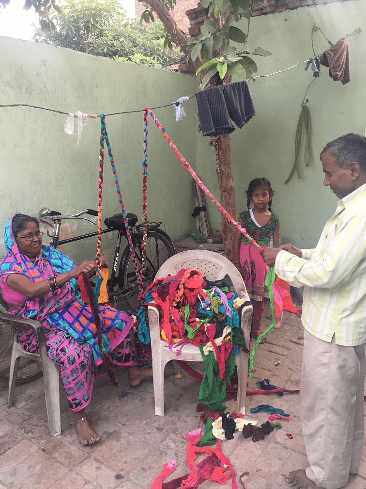 Men and women making chindi rope in India